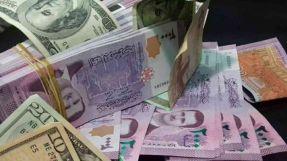 الدولار يسجل تراجعاَ  في افتتاح  تداولات الأحد