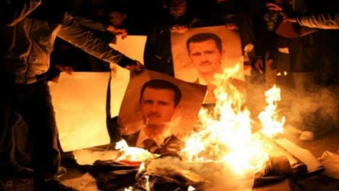 كتابات مناهضة للنظام  ...وإحراق صورة لبشار الأسد في مدينة التل بريف دمشق