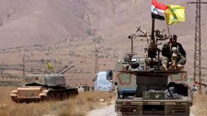 خوفاً من  استهدافها ...الميليشيات الإيرانية تستبدل  راياتها  بأعلام  النظام  في محيط تدمر