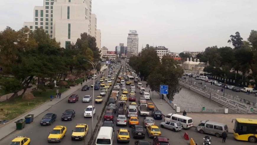Bashar Al-Assad issues a law allowing owners of private vehicles to transport passengers