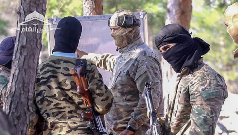 Hay'at Tahrir Al-sham broadcasts a video recording the confessions of the killers who killed Minister of Education in Idlib