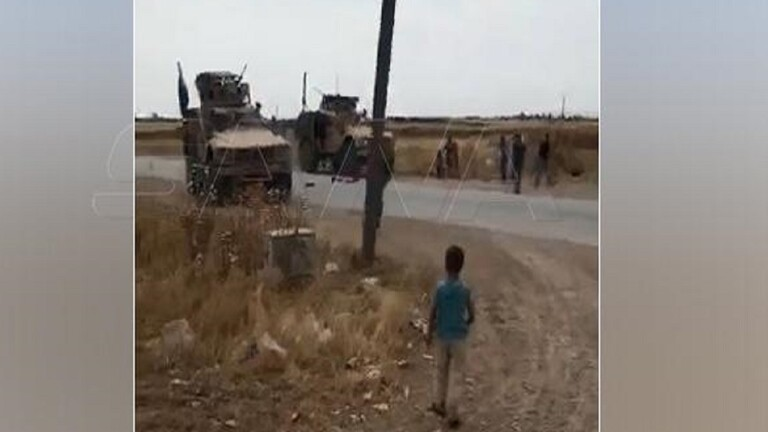 Residents of a Syrian village intercept an American military convoy