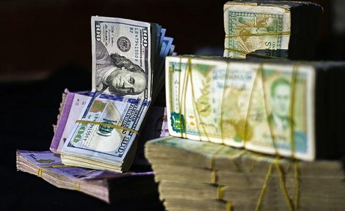 تحسن  ملحوظ في أسعار الدولار والذهب عند  إغلاق  تداولات الاثنين