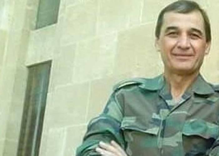 اللواء حسام لوقا يطالب وجهاء درعا بترميم مبنى الدولة ويهددهم بحرق منازلهم وتدميرها